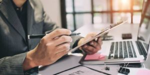 Employer reviewing the employee benefits compliance checklist