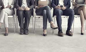 Prospective employees waiting to be interviewed by a professional employer organization