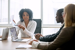 business owners reviewing an employee benefits compliance checklist