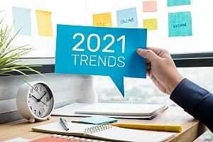 Person holding 2021 trends sign