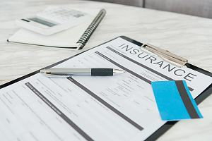 Insurance documents sitting on table