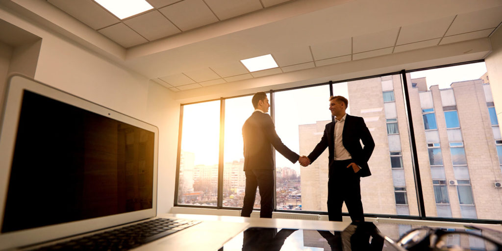 two business men meeting to discuss peo