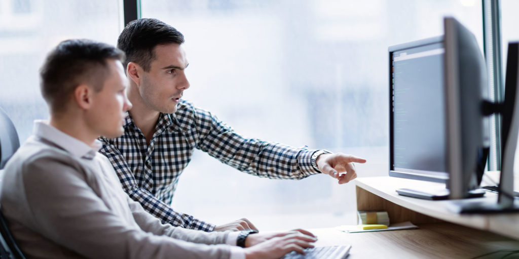 two men looking at benefits technology