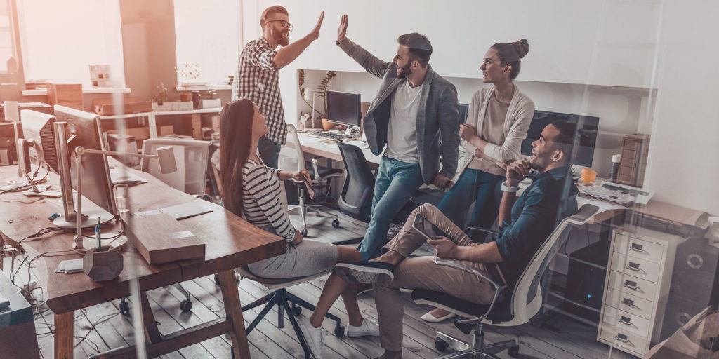group of employees happy in their office