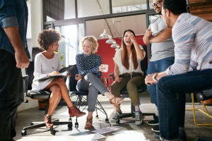 group of office workers happy with their employee benefits