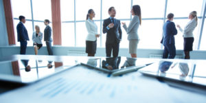 employees discuss what they notice after the first phase of benchmarking