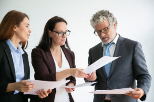 employees trade documents on the benchmarking of the company to gain new insights