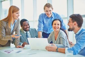 group of business workers at conference table learning what level funding is