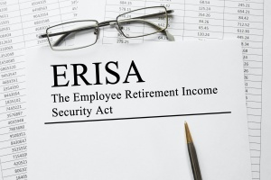 paper and pencil explaining what is considered an ERISA plan