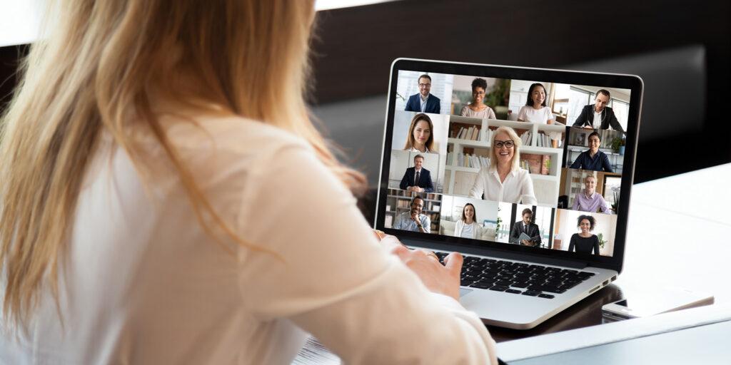 employee in meeting over computer