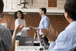 company shaking hands with employee