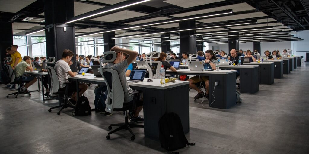 Enhance Company Benefits- Employees Working in the Office