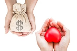 Hands Holding Money and Heart for people with group health insurance plan