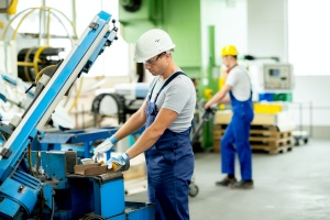 worker happy with his Employee Benefits in the Manufacturing Company