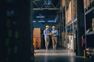 two men talking about Best Employee Benefits to Offer as a Growing Manufacturing Company