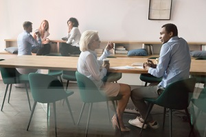 employees having conversation in a room working for different Manufacturing Companies