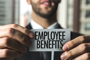 man holding employee benefits note for the employee benefits guide