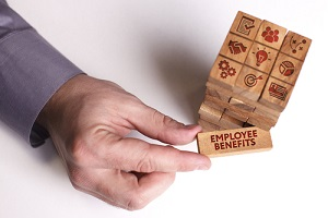 wooden blocks with employee benefits in the Manufacturing Companies