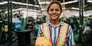 women working for manufacturing companies smiling