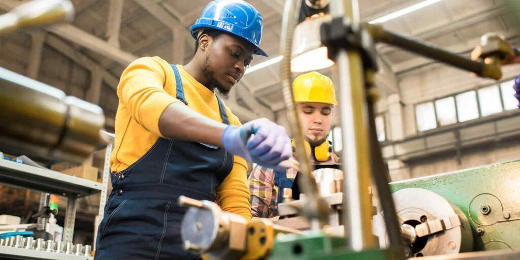 two manufacturing employee working to gain executive bonus plans