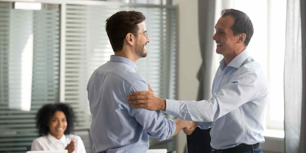 shaking hands on a Employee Benefits Strategies