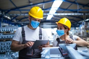 employees with Competitive Benefits wearing masks working in manufacturing factory