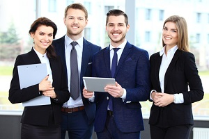 happy smiling business team in office of a Manufacturing Companies with benefits