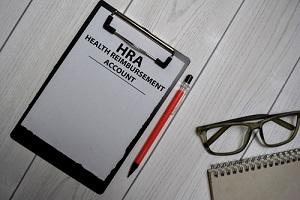 health reimbursement account write on a paperwork isolated on office desk