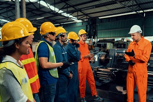 worker attending brief meeting in the factory with to insurance premiums