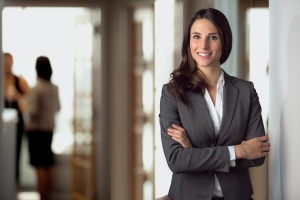 business women smiling with her Employee benefits compliance