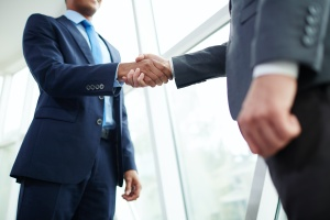 Handshake taking place for a Insurance Services