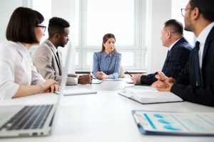 women executive who is listening to a Executive Benefits