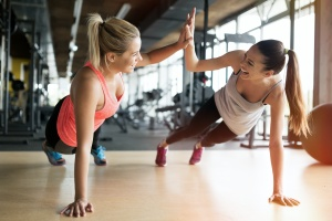 women working out becuase of their shoes of women going to gym because of her Wellness Plans