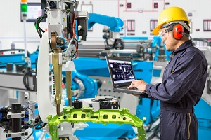 engineer with Competitive Employee Benefits using laptop computer maintenance automatic robotic hand machine tool