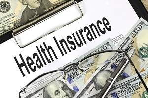 health insurance on clipboard with specs