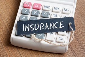Insurance Premiums words written on label with calculator