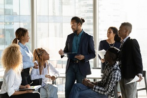 multiethnic businesspeople gather at casual meeting in office for Employee Benefits Consulting Firm